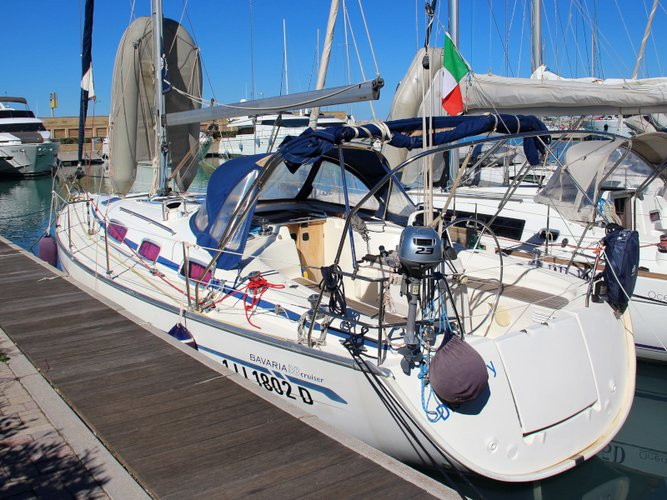 Sail the beautiful waters of San Vincenzo on this cozy Bavaria Yachtbau Bavaria 38 Cruiser