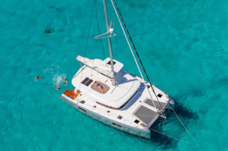 Feel the waves of British Virgin Island water aboard this 42ft catamaran