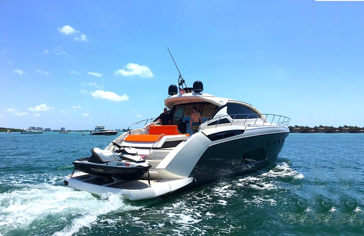 Discover Miami Beach surroundings on this 58' Azimut boat