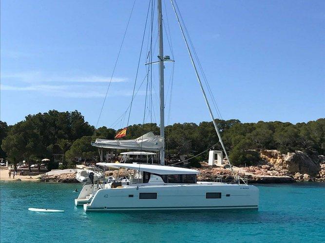 Enjoy Ibiza - Sant Antoni de Portmany, ES to the fullest on our comfortable Lagoon Lagoon 42
