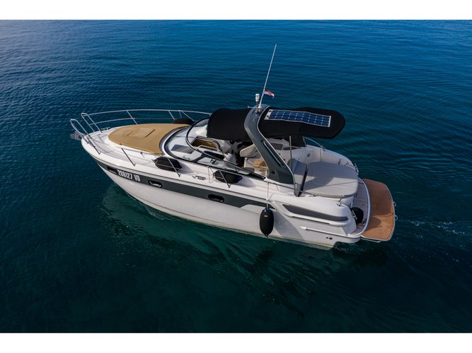 Sail the beautiful waters of Tribunj on this cozy Bavaria Yachtbau Bavaria 29 Sport
