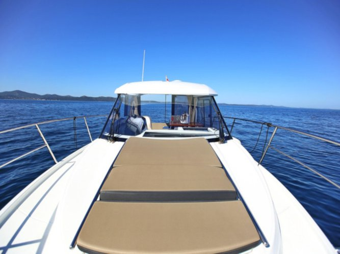 Sail the beautiful waters of  on this cozy Jeanneau Merry Fisher 895