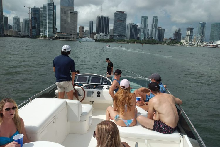 Discover Miami Beach surroundings on this Flybridge Uniesse boat