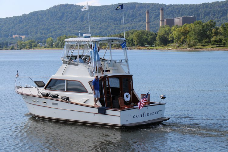 Confluence is a classic converted sport fisherman totally refit and beautiful