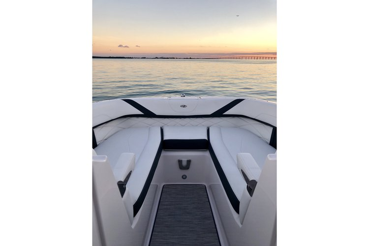 Discover Miami Beach surroundings on this 26 OBX Regal boat