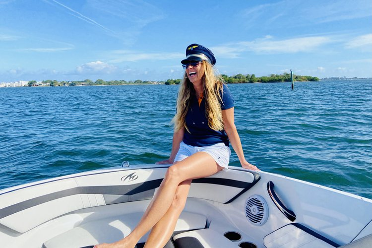 Discover Miami Beach surroundings on this M205 Monterey boat