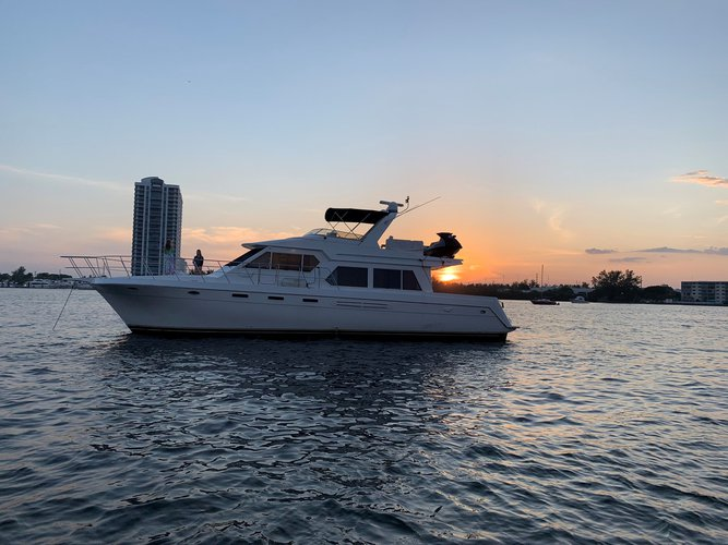 Discover North Miami Beach surroundings on this 57 Rival Navigator boat