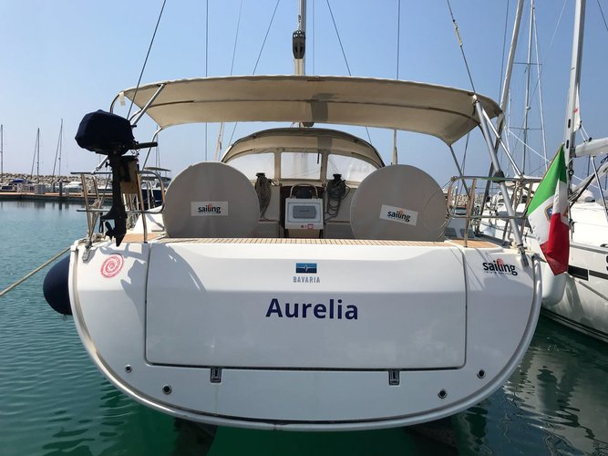 Sail the beautiful waters of Campania on this cozy Bavaria Yachtbau Bavaria Cruiser 51