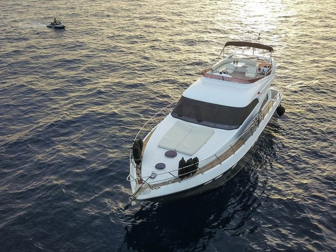 Cruise Mykonos, GR waters on a beautiful Fairline Boats Fairline Squadron 55