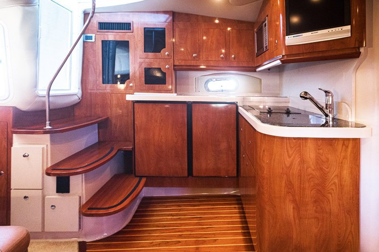 Discover Puerto surroundings on this 38 Four Winns boat